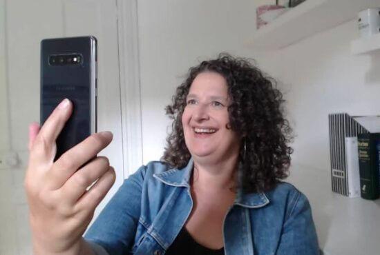 video marketing expert Andrea Stenberg records an Instagram Reel using her smartphone